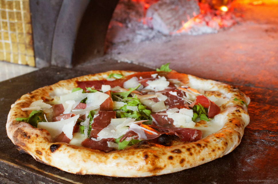 Indulge in one of Rossopomodoro's pizzas, cooked to perfection!